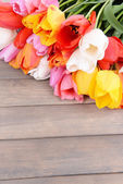 Beautiful tulips in bucket on table close-up — ストック写真