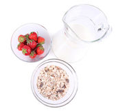 Healthy cereal in bowl with milk and strawberries isolated on white — Stock Photo