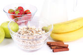 Healthy cereal with milk and fruits close up — Stock Photo