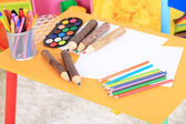 Interior of classroom at school. Crayons and paper on table — Stockfoto