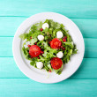 Salad made with arugula, tomatoes, cheese mozzarella — Stock Photo #46932457