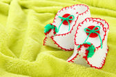 Decorative Christmas shoes on fabric background — Stock Photo