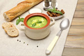 Tasty soup in saucepan on wooden table, close up — Stock Photo