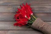 Beautiful red tulips on wooden background — Stock Photo