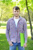 Happy student in park — Stock Photo