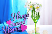 Freesias in glass on table on fabric background — Stock Photo