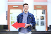 Man with pointer outdoors — Stock Photo
