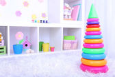 Plastic toy pyramid in children room — Stock Photo