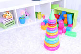 Colorful plastic toys in children room — Stock fotografie