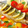 Delicious grilled fish on plate on table close-up — Stock Photo #47212557