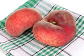 Ripe fig peaches on napkin isolated on whit — Stockfoto