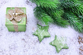 Christmas decorations and fir tree on light background — Stock Photo