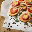 Small pizzas on baking paper close up — Stock Photo #47339109