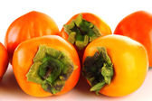 Ripe persimmons isolated on white — Stock Photo