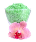 Color sea salt in glass bowl and  orchid flower, isolated on white — Stock fotografie
