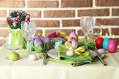 Beautiful holiday Easter table setting, on bright background  — Stock Photo