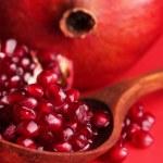 Ripe pomegranates on red background — Stock Photo #47340279