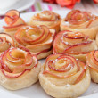 Tasty puff pastry with apple shaped roses on plate on table close-up — Stock Photo #47341623
