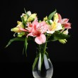 Alstroemeria flowers in vase on table on dark grey background — Stock Photo #47345301