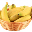Bunch of mini bananas in wicker basket isolated on white — Stock Photo #47348929