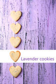 Lavender cookies on color wooden background — Stock Photo