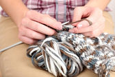 Female hands knitting with spokes close up — Stock Photo