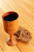 Cup of wine and bread on table close-up — Stock Photo