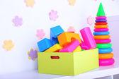 Colorful plastic toys on decorative — Stock Photo