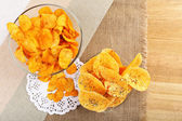 Homemade potato chips in glass bowls on table — Stock Photo