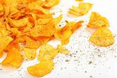 Homemade potato chips isolated on white — Stock Photo