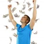 Happy man enjoying rain of money, isolated on white — Stock Photo