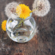 Dandelions flowers on old wooden background — Stock Photo #47397765