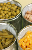 Open tin cans of peas, corn, bean and french bean close-up — Stock Photo