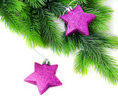 Christmas decorative stars on fir tree, isolated on white — Stockfoto