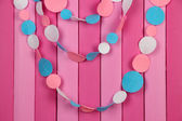 Decorative felt garland on wooden background — Photo