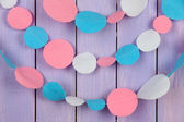 Decorative felt garland on wooden background — ストック写真