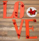 Romantic still life with strawberries — Stock Photo