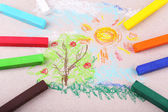 Colorful chalk pastels and simple picture on color paper background — Stock Photo