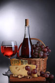 Pink wine, grapes and cheese on black background — Stock Photo