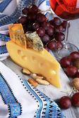Different kinds of cheese with wine on table close-up — Stock Photo