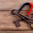 Magnet with old keys on wooden background — Stock Photo #47401227