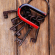 Magnet with old keys on wooden background — Stock Photo #47401239