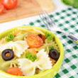 Delicious pasta with tomatoes on plate on table close-up — Stock Photo #47473425