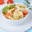 Delicious pasta with tomatoes on plate on table close-up — Stock Photo #47538697