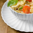 Delicious pasta with tomatoes on plate on table close-up — Stock Photo #47539211