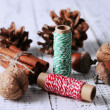 Composition with natural bump, thread, cinnamon sticks on wooden background — Stock Photo #47539459