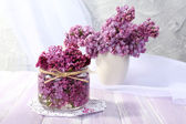 Beautiful lilac flowers on wooden table — Stok fotoğraf