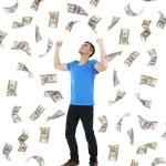 Happy man enjoying rain of money, isolated on white — Stock Photo #47543757