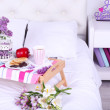 Light breakfast and beautiful bouquet on bed — Stock Photo #47544687