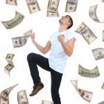 Happy man enjoying rain of money, isolated on white — Stock Photo #47549381